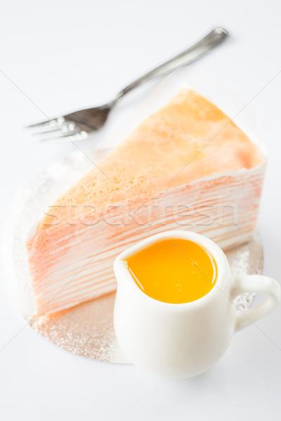 Orange whipped cream crepe cake on white background Stock photo © nalinratphi