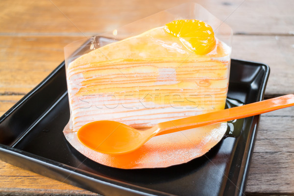 Delicious fresh orange crepe cake with sauce Stock photo © nalinratphi