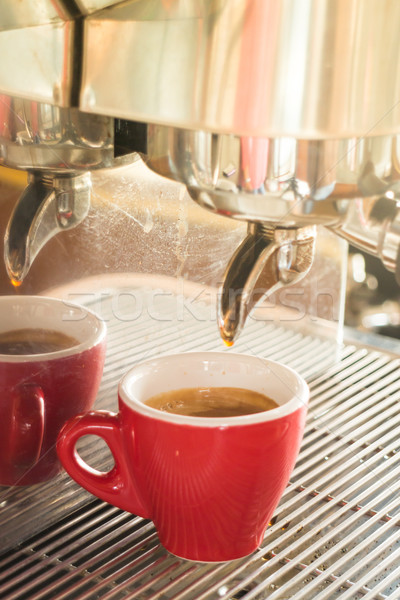 Fresh brewing hot coffee from espresso machine with vintage filt Stock photo © nalinratphi