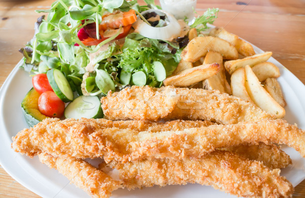 Gourmet fish and chips with salad Stock photo © nalinratphi