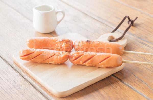 Pork hotdog grilled on wooden plate Stock photo © nalinratphi