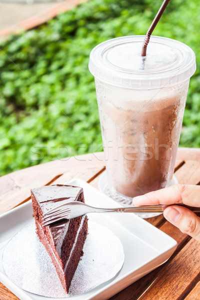 Custard chocolate cake and iced coffee serving on table Stock photo © nalinratphi