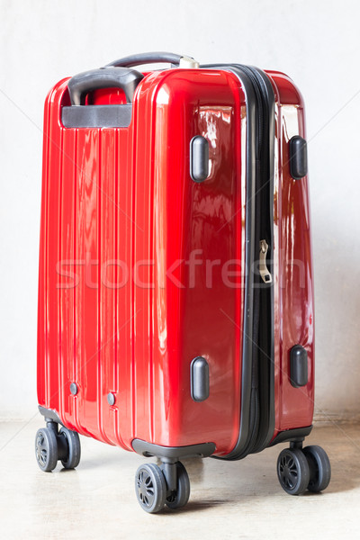 Red travel suitcase for outgoing Stock photo © nalinratphi