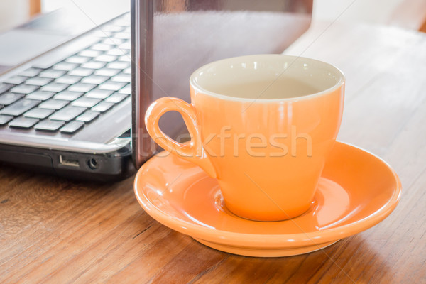 Hot cup of tea on work table Stock photo © nalinratphi