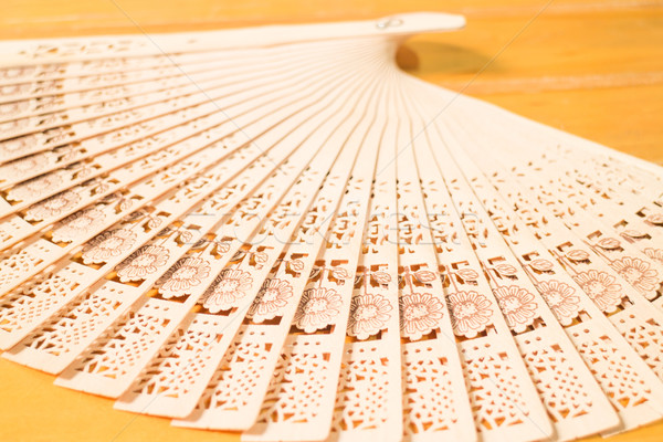 Oriental carved wooden hand fan Stock photo © nalinratphi
