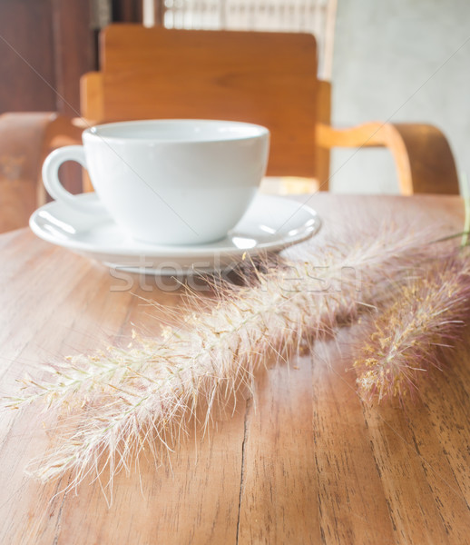Hot coffee cup on wooden table Stock photo © nalinratphi