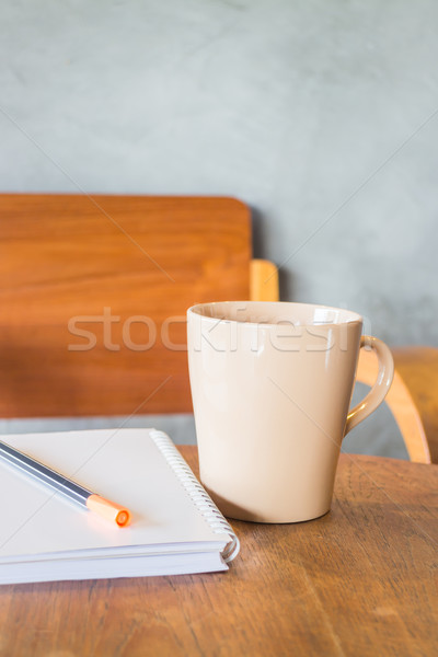 Stock photo: Beautiful wooden work table with cup of coffee