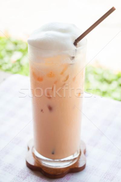 A glass of iced thai milk tea  Stock photo © nalinratphi