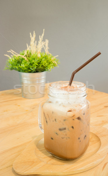 Iced cofee mocha drink serving on wooden table Stock photo © nalinratphi