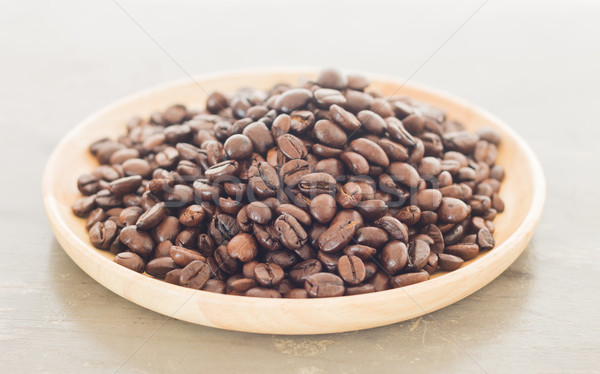 Roast coffee bean on wooden plate Stock photo © nalinratphi