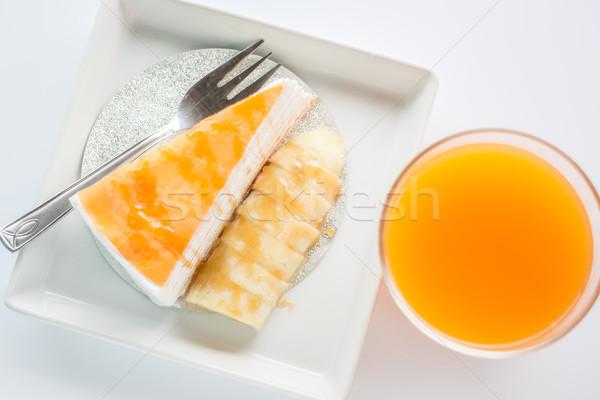 Top view of banana caramel crepe cake and orange juice on white  Stock photo © nalinratphi