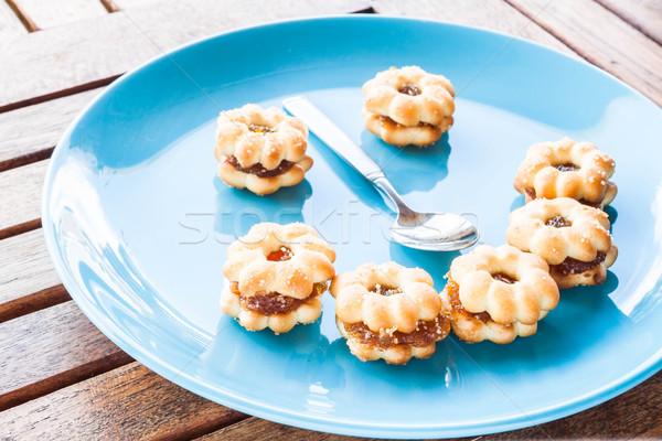 Lachend gezicht ananas biscuits houten tafel voorraad foto Stockfoto © nalinratphi