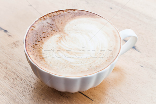 Free pour hot coffee latte art cup on wood background Stock photo © nalinratphi
