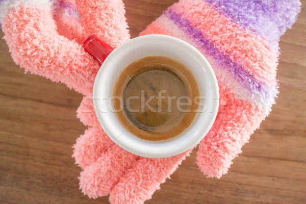Gloved hands holding cup of coffee Stock photo © nalinratphi