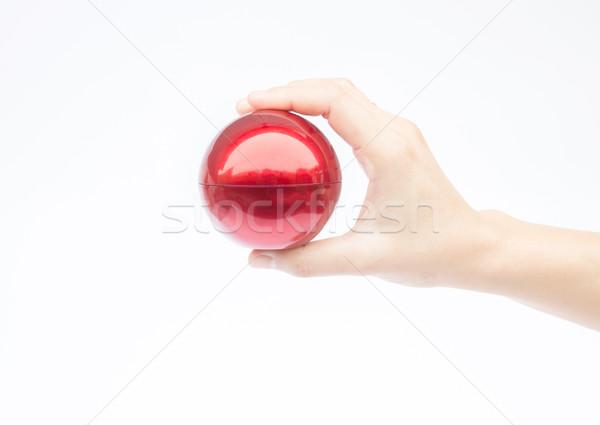 Kéz fényes piros labda fehér stock Stock fotó © nalinratphi