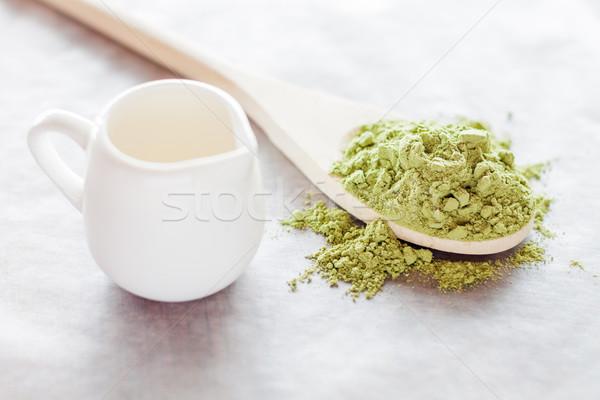 Powdered green tea ingredient and fresh milk Stock photo © nalinratphi
