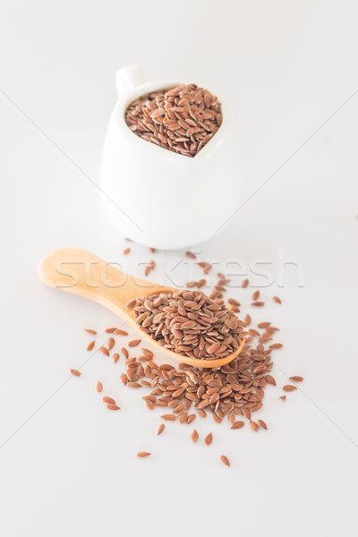 Brown flax seed on clean kitchen table  Stock photo © nalinratphi