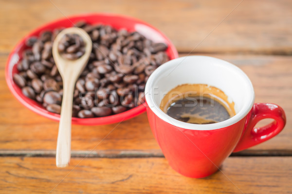 Fresh brewed hot espresso with roasted bean Stock photo © nalinratphi