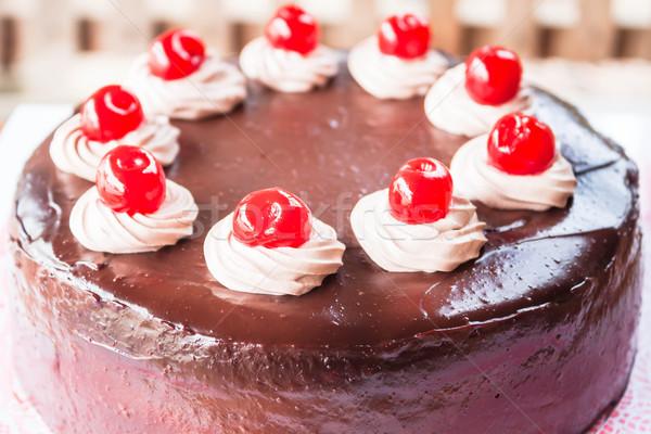 Chocolate cake with cherry and whipped cream  Stock photo © nalinratphi