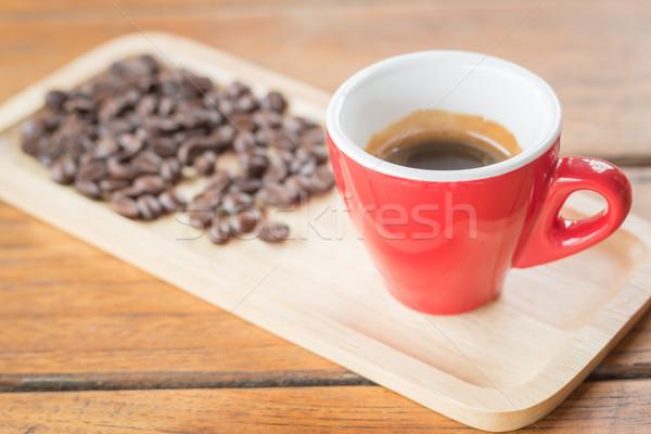 Fresh brewed hot espresso with roasted bean Stock photo © nalinratphi