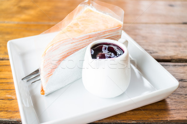 Whipped cream crepe cake with blueberry sauce Stock photo © nalinratphi