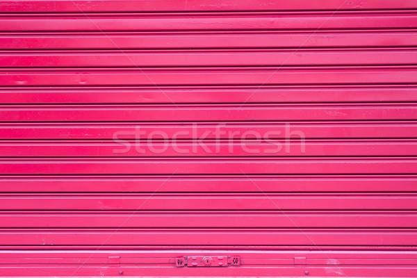 Red roller metal door surface of apartment Stock photo © nalinratphi