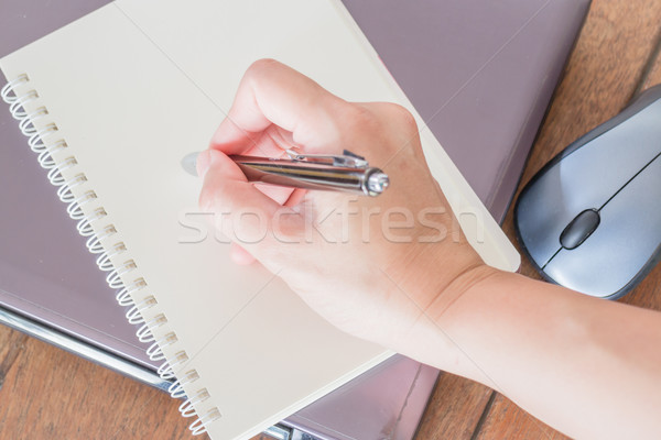 Hand writing on note paper at workplace Stock photo © nalinratphi