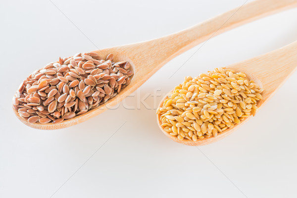 Flax seeds on wooden spoon Stock photo © nalinratphi