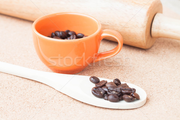 Roast coffee bean in a cup and wood spoon  Stock photo © nalinratphi
