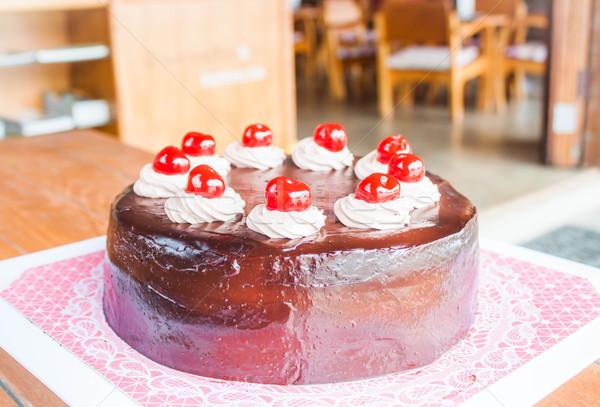 Chocolate cake with red cherry and whipped cream  Stock photo © nalinratphi