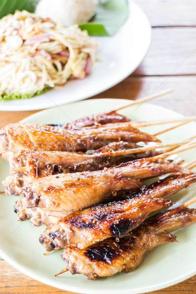 Grilled chicken serving with papaya salad Stock photo © nalinratphi