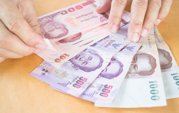Man hand counting Thai baht banknote  Stock photo © nalinratphi