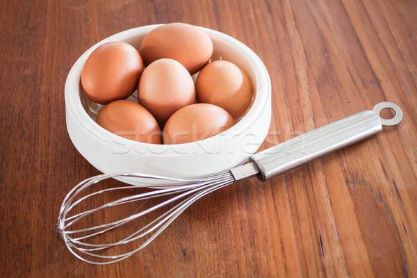 Fresh chicken eggs and hand mixer for beating Stock photo © nalinratphi