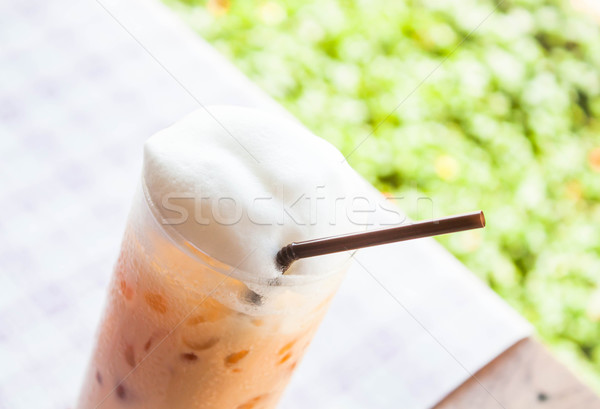 A glass of thai milk tea with ice cube Stock photo © nalinratphi