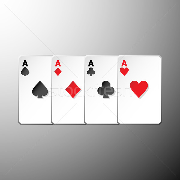 Four playing cards suits symbols on gray background Stock photo © nalinratphi