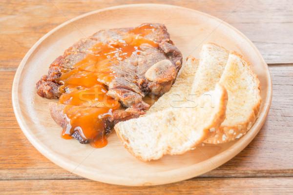 Disznóhús steak fából készült tányér stock fotó Stock fotó © nalinratphi