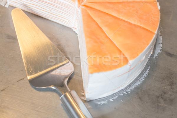 Piece of orange crepe cake Stock photo © nalinratphi