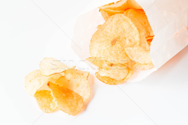 Potato chips snack falling out of the pack Stock photo © nalinratphi