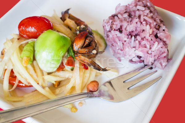 Spicy papaya salad (Som Tum) with berry sticky rice Stock photo © nalinratphi