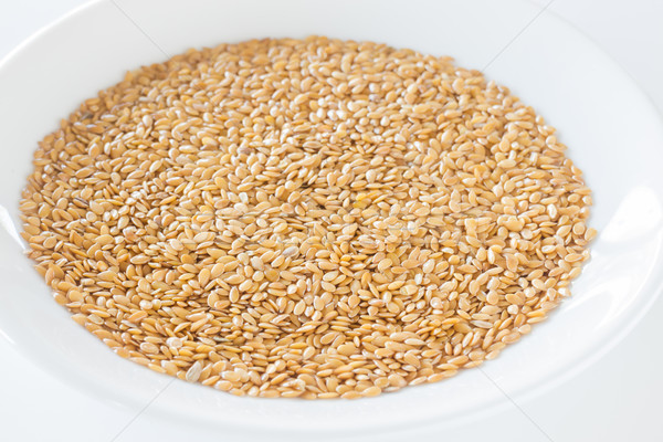 Organic gold flax seeds on a plate Stock photo © nalinratphi