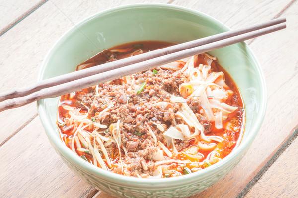 Baharatlı çorba Çin yemek çubukları ahşap masa gıda Stok fotoğraf © nalinratphi