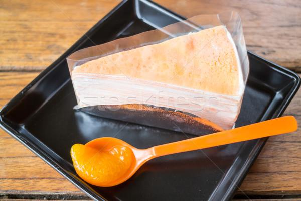Whipped cream crepe cake with fresh orange  Stock photo © nalinratphi