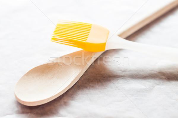 Spoon and brush on baking paper Stock photo © nalinratphi