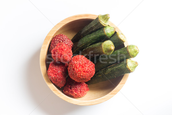Okra chips and crispy strawberry in wooden bowl Stock photo © nalinratphi