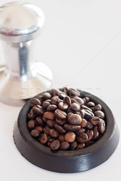 Middle roasted coffee bean in rubber saucer Stock photo © nalinratphi
