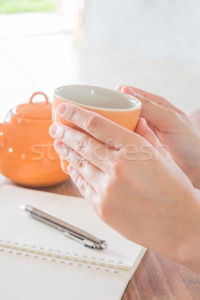 Kéz tart forró teáscsésze stock fotó Stock fotó © nalinratphi