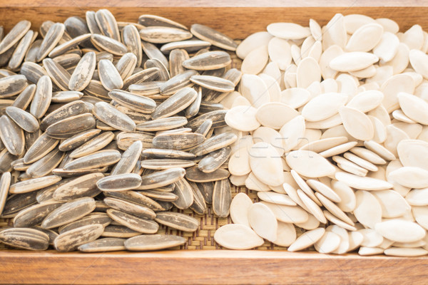 Assorted of whole grain sunflower and pumpkin on wooden table Stock photo © nalinratphi