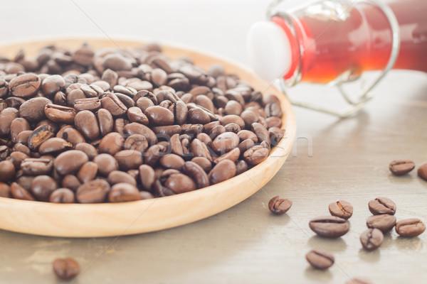Roast coffee bean on wooden plate Stock photo © nalinratphi