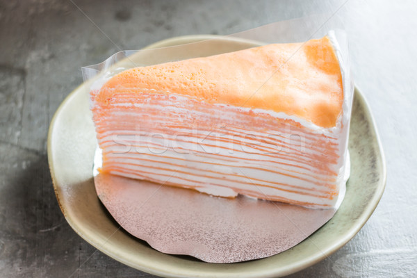 Piece of homemade orange crepe cake Stock photo © nalinratphi