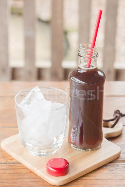 бутылку черный кофе льда складе фото саду Сток-фото © nalinratphi